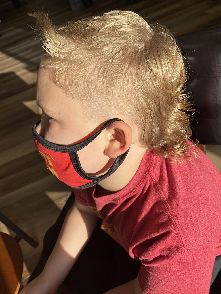 Boy's haircut with faded Mohawk.