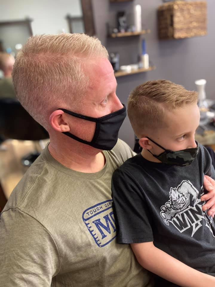 Father and Son get a haircut together.