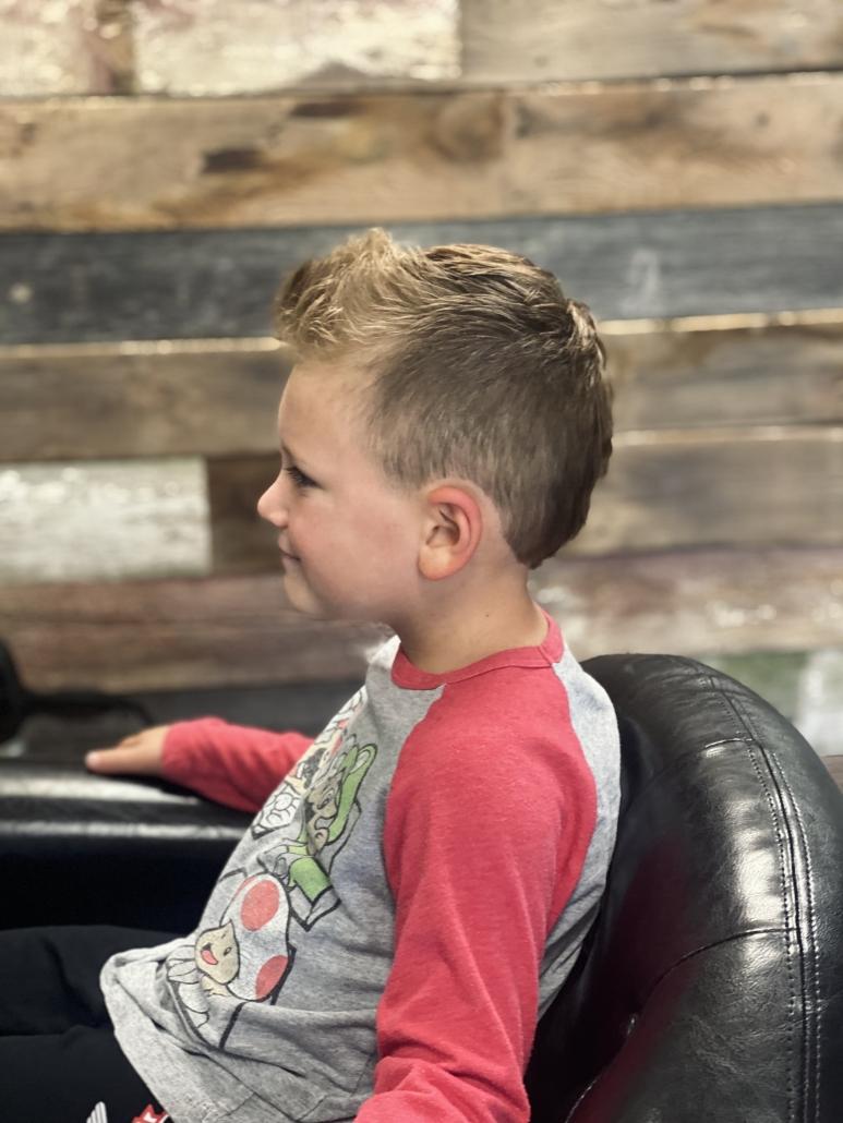 Boy's short haircut.